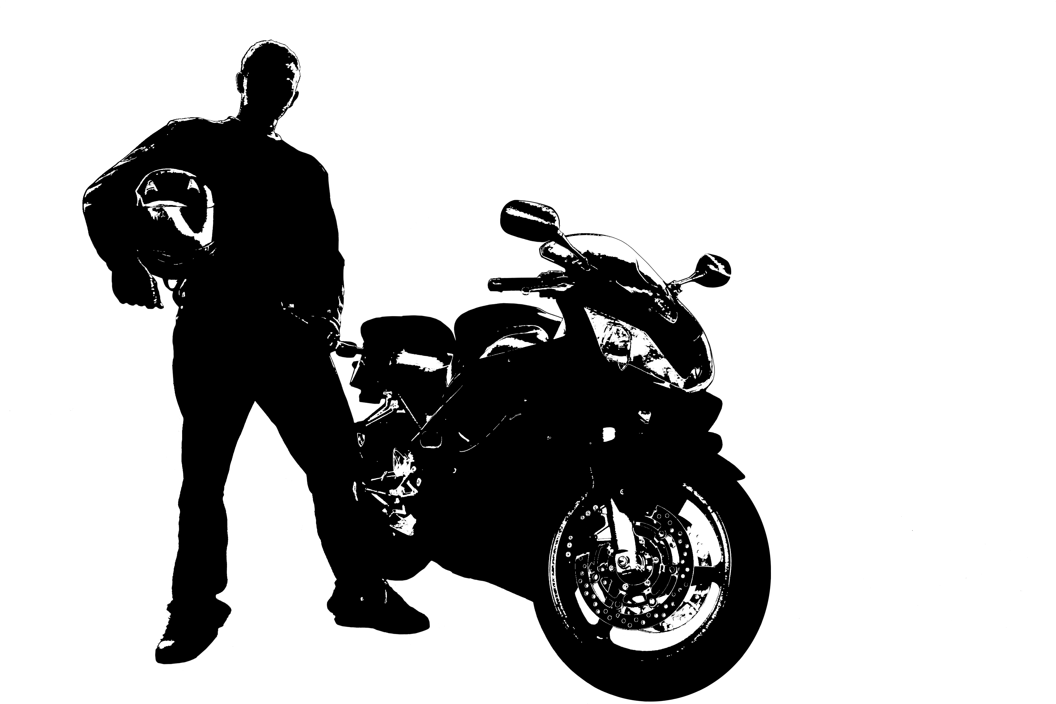 A man standing next to his motorcycle